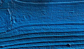 Treteknisk forsker på brannhemmende maling for trebygg