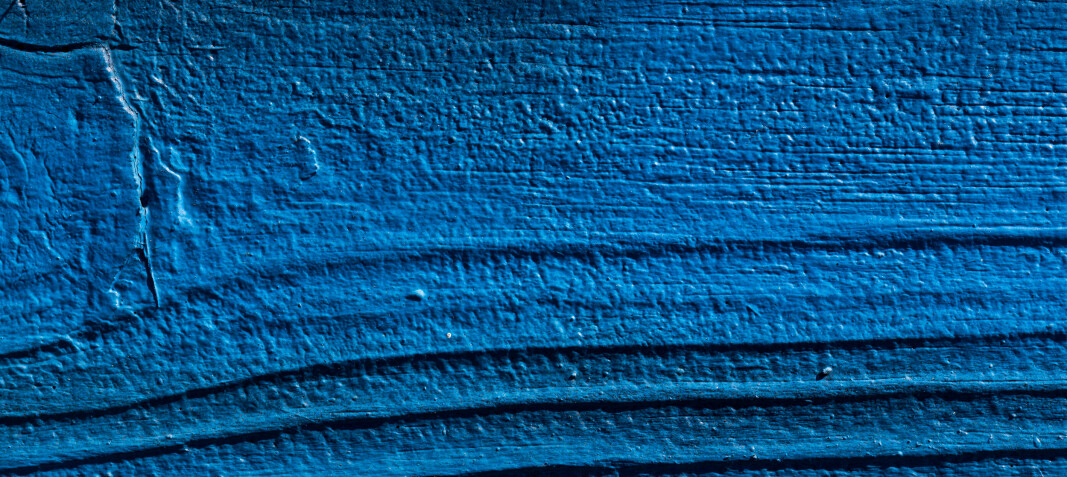 Plank of wood painted in blue texture